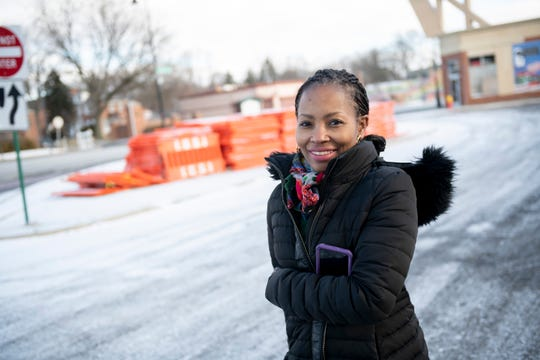 Sherita Smith, the executive director of the Grandmont Rosedale Development Corporation, stands next to what will be a parklet built on a small parcel of land wedged inside the intersection of Grand River, Puritan and Plainview streets.
