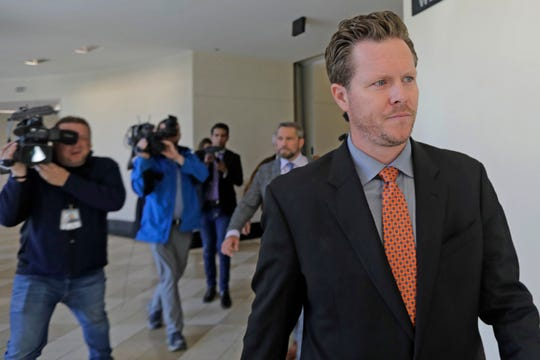 FILE - In this Nov. 15, 2019, file photo, Paul Petersen, an Arizona elected official accused of running a multi-state adoption scheme, leaves court following an initial appearance on charges filed in the state in Salt Lake City.