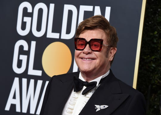 FILE - In a Sunday, Jan. 5, 2020 file photo, Elton John arrives at the 77th annual Golden Globe Awards at the Beverly Hilton Hotel, in Beverly Hills, Calif.