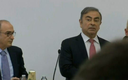 Former Nissan chairman Carlos Ghosn, right, faces the media in Beirut, Lebanon, Wednesday Jan. 8, 2020.