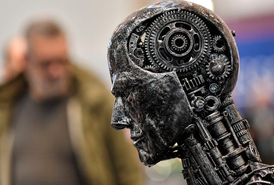 FILE - In this Nov. 29, 2019, file photo, a metal head made of motor parts symbolizes artificial intelligence, or AI, at the Essen Motor Show for tuning and motorsports in Essen, Germany.