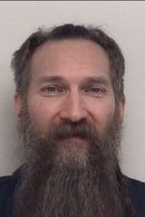 This undated booking photo provided by the Shiawassee County, Mich., Sheriff's Office shows Mark Latunski is shown.