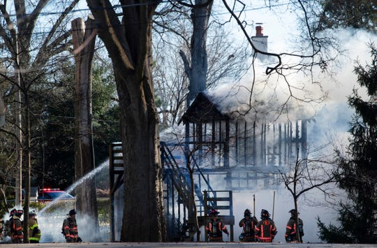Evansville firefighters put water on a two-story playset in the backyard of a home 2423 Lincoln Avenue Tuesday morning, Jan. 8, 2020. Nobody was hurt in the blaze and the cause of the fire is under investigation.