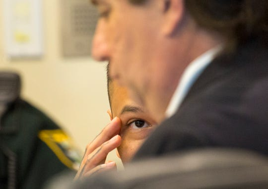 Accused Zombicon shooter Jose Bonilla talks to his attorney on Wednesday, Jan. 8, 2020, while in court for a motions hearing before his murder trial. He is accused of killing Expavious Tyrell Taylor and wounding five others in the 2015 shooting. Bonilla's trial is scheduled to begin Monday.