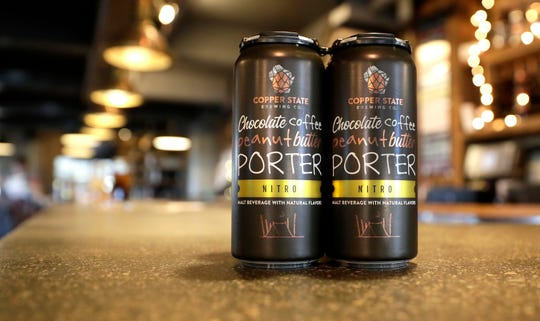 Cans of Copper State Brewing Co.'s Chocolate Peanut Butter Nitro Porter, are pictured at the downtown Green Bay brewery and restaurant. Cans of the popular taproom beer will be released on Jan. 10, 2020.