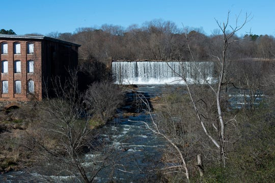 Water flows at the dam at Lake Conestee Wednesday, Jan. 8, 2020.