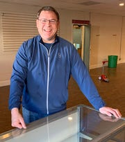 Mike Martin poses for a photo at what will be the counter for admission to the new Upstate Pinball & Arcade Museum he plans to open in downtown Simpsonville in a space vacated by the closing of the Country Store at Vaughn's on West Trade Street. Martin is pictured here on Tuesday, Jan. 7, 2020.