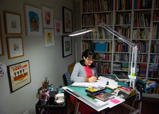 Hallie Bertling works on sketches at her home studio in Greenville.