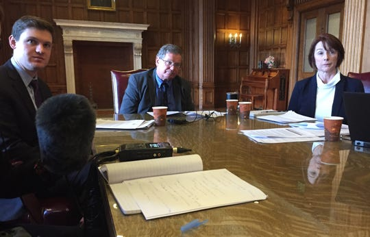 From left, Gov. Steve Bullock's chief legal counsel, Raph Graybill, Budget Director Tom Livers and Department of Public Health and Human Services Director Sheila Hogan discuss bonding issues Tuesday during a news conference.