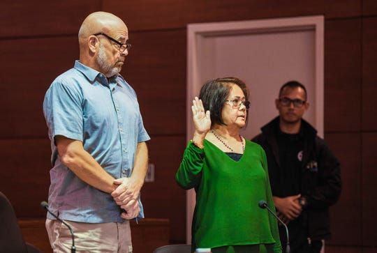 Defendant Yolanda Digomon is sworn in prior to submitting testimony, as she stands with her attorney, Tom Fisher, during her change of plea hearing before Superior Court of Guam Judge Maria Cenzon at the Guam Judicial Center in Hagåtña on Wednesday, Jan. 8, 2020. Digomon pleaded guilty for unlawfully using, transferring or receiving food stamps and fraudulently using public assistance while working as a government employee with the Supplemental Nutrition Assistance Program.