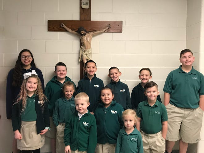 The December 2019 Holy Name Cardinals of the Month are, front row from left, Bennett Harpole and Kensie Barkley. Middle row, from left Hadley Martin, Isabellla Hurtte, Zoey Flores, and Ben Mathis. Back row from left, Kassie Toribio, Hanley Floyd, Jace Benton, Easton McGill, Collin Hansen, and Gabe Sheffer.