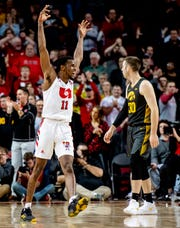 Iowa players, including Connor McCaffery (30), had to watch Nebraska guard Dachon Burke Jr. celebrate a 76-70 Cornhuskers win. The Hawkeyes are adjusting to life without Jordan Bohannon in close games down the stretch.