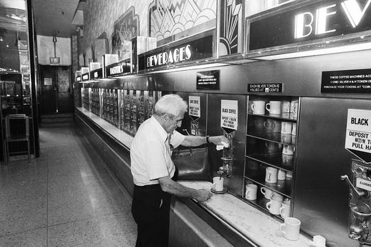A customer buys a cup of coffee at the only surviving Horn & Hardart Automat eatery in midtown Manhattan, New York City, on June 8, 1987. The Philadelphia/New York restaurant chain, founded in 1888, became known for its coffee and coin-operated Automat.