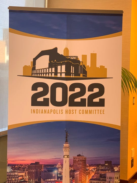 Logo for the 2022 Indianapolis Host Committee. Indy will host the 2021 College Football National Championship January 2022.