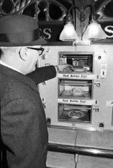 Ralph MacNeil, an official of Horn & Hardart, serves one of the last slices of pie to go through a window in the nation's first automat restaurant in Philadelphia. The firm closed the restaurant in December 1968, blaming the closing on its inefficiency and slowness.