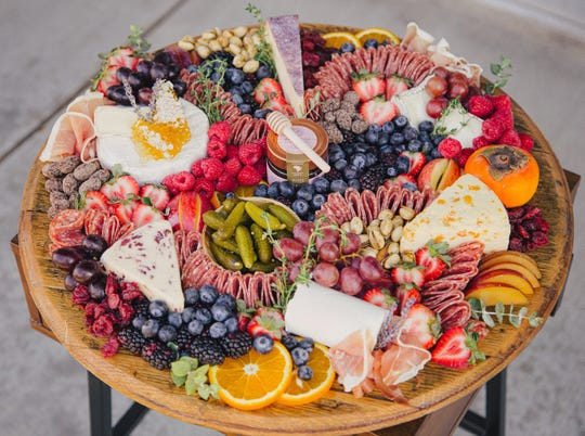 Salami, cheeses, pickles, fruit, honey and nuts cover a grazing board by Board & You, which is coming to Indianapolis' north side in spring 2019.
