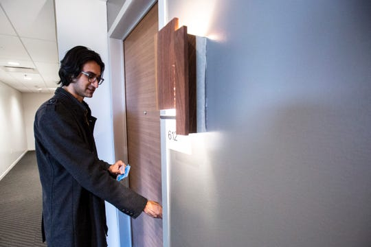 Raj Patel, chief development officer of Hawkeye Hotels, opens a door to a room, Wednesday, Jan. 8, 2020, at Hotel Chauncey in Iowa City, Iowa.