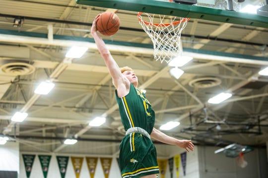 Dubuque Hempstead guard Michael Daux (15) dunks during a Class 4A boys' varsity basketball game, Tuesday, Jan. 7, 2020, at West High School in Iowa City, Iowa.