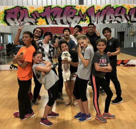 Students pose in hip-hop style at All The Way Up Studio in North Liberty, said to be the first and only dance studio in the state devoted to this style of performance art.