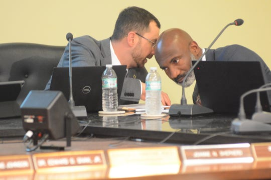 Jackson Public Schools Trustee Edward D. Sivak Jr., left, discusses an agenda item with Superintendent Errick Greene at a Jan. 7, 2020, board meeting. Trustees went on to approve a major overhaul that includes the shuttering of an elementary school and the consolidation of four middle schools.