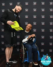 WWE superstar Roman Reigns reads a 'Thank You' card from his biggest fan Markel Smith.