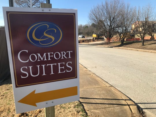 A detour sign shows drivers how to get around the cave-in on Casey Jones Lane and get to Comfort Suites in North Jackson.