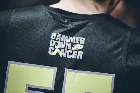 The Purdue men's basketball team unveiled jerseys it will wear against Wisconsin on Jan. 24, 2020, to support the Tyler Trent Endowment Fund and the Purdue Center for Cancer Research. The jerseys say Hammer Down Cancer with a yellow ribbon, which symbolizes bone cancer.
