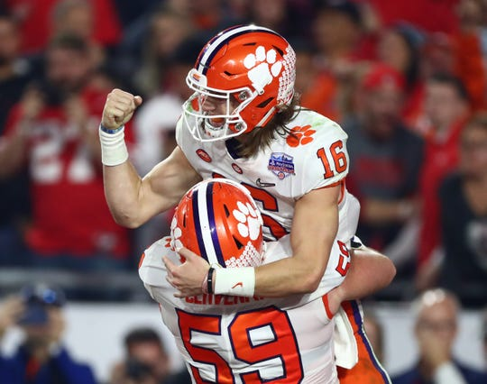 Dec 28, 2019; Glendale, AZ, USA; Clemson Tigers quarterback Trevor Lawrence (16) celebrates with teammates after scoring a touchdown against the Ohio State Buckeyes during the first half in the 2019 Fiesta Bowl college football playoff semifinal game at State Farm Stadium. Mandatory Credit: Matthew Emmons-USA TODAY Sports
