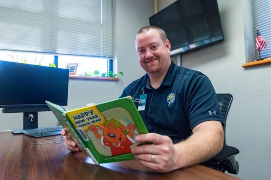J. Wallace James Elementary Principal Jon Downs reads aloud to his school family each week through a video included in a school newsletter.  Wednesday, Jan. 8, 2020.