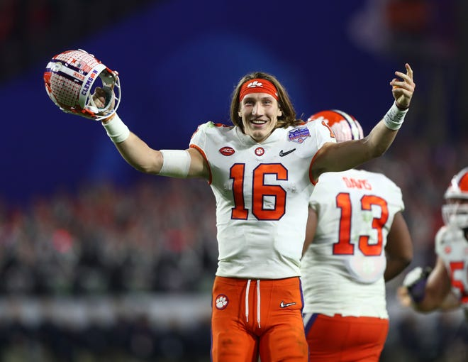 Dec 28, 2019; Glendale, AZ, USA; Clemson Tigers quarterback Trevor Lawrence (16) celebrates in the 4th quarter against the Ohio State Buckeyes in the 2019 Fiesta Bowl college football playoff semifinal game at State Farm Stadium. Mandatory Credit: Mark J. Rebilas-USA TODAY Sports