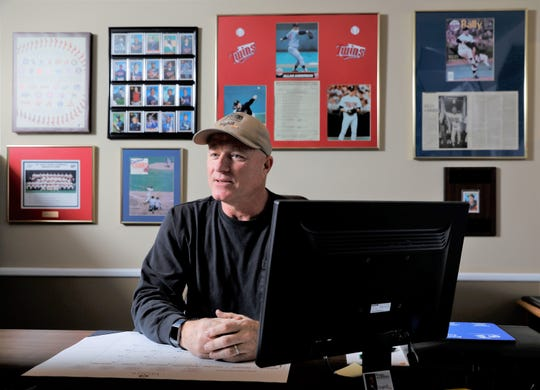 Allan Anderson sits at his desk Monday morning, Dec. 30, 2019, at Better Homes and Gardens Bighill real estate in Lancaster. Anderson, a former major league baseball player for the Minnesota Twins, is also a captain with the Columbus fire department.