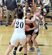 Lancaster's Halle Spangler drives between two Canal Winchester defenders during the Lady Gales' 63-35 non-conference loss Tuesday night.