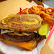 A patty melt on rye break with Swiss and cheddar cheeses and caramelized onions is on the menu at Wings Etc. Grill & Pub franchises.