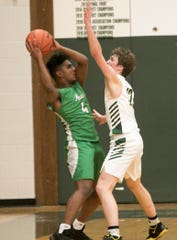 Novi's Varun Reddy is guarded by Howell's Tony Honkala on Tuesday, Jan. 7, 2020