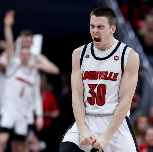Louisville's Ryan McMahon celebrates after knocking down a three against Miami on Jan. 7, 2020.