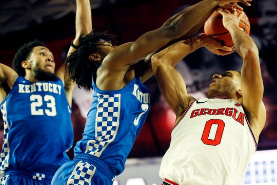 Kentucky guard Tyrese Maxey (3) blocks a shot from Georgia's Donnell Gresham Jr. (0) on Tuesday in Athens, Georgia.