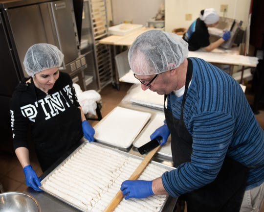 Fadi Assaf, right, and Dina Kasti of Bread Bites in Okemos, prepare freshly-made lady fingers and baklava, Wednesday, Jan. 8, 2020. The family-owned Mediterranean bakery and restaurant opened Dec. 27.