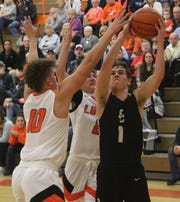 South Central's Simon Blair goes to the rim in traffic during the Trojans'70-54 loss to Lucas on Tuesday.