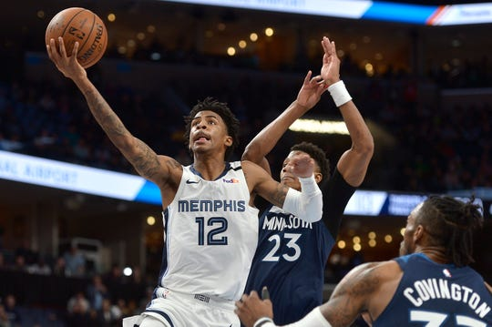 Memphis Grizzlies guard Ja Morant (12) shoots ahead of Minnesota Timberwolves guard Jarrett Culver (23) in the second half of an NBA basketball game Tuesday, Jan. 7, 2020, in Memphis, Tenn.