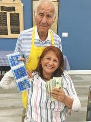 JCMI Bingo winner Flor Gutierrez with member Dr. Herb Kern.