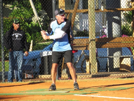 Snook Inn's Fred Pendergrass prepares himself in the batter's box ready to lash out one of his three hits in the game against Sand Bar.