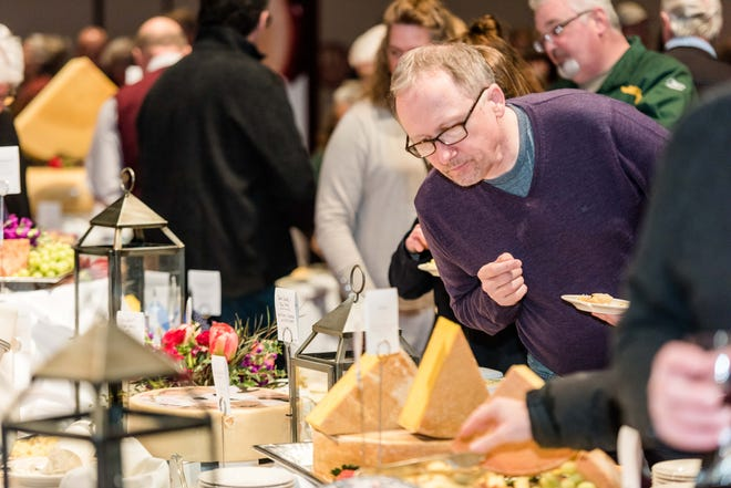 Visitors to Cheese Champion, the public event of the biennial World Championship Cheese Contest in Madison, sample cheeses from around the world, as in this photo from the 2018 event. This year's Cheese Champion takes place March 5.