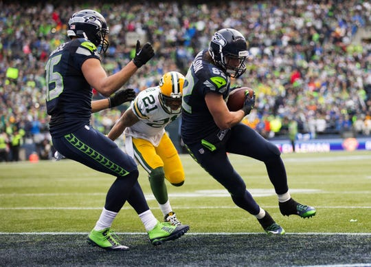 Seattle Seahawks tight end Luke Willson scores a two-point conversion during the fourth quarter on Sunday, Jan. 18, 2015, at CenturyLink Field in Seattle.