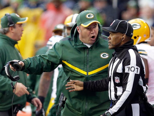 Packers head coach Mike McCarthy argues with a ref over a call in the second half during the Seattle Seahawks 28-22 overtime win over the Green Bay Packers to win the NFC Championship football game at CenturyLink field in Seattle, Washington, Sunday, January 18, 2015.