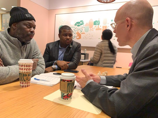 GOP Rep. Scott Allen, right, talks about improving relations with Democrats in the Assembly at a Starbucks in north Milwaukee on Tuesday, Jan. 7, with Democratic Rep. Kalan Haywood, middle, and Republican Orlando Owens of Milwaukee.