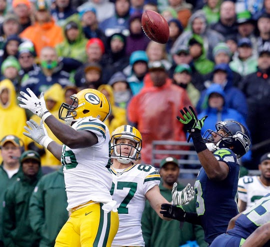 Green Bay Packers tight end Brandon Bostick (86) made the initial touch on the ball but couldn't hang on while allowed a Seattle drive to continue with a  28-22 overtime win over the Green Bay Packers to win the NFC Championship football game at CenturyLink field in Seattle, Washington, Sunday, January 18, 2015.