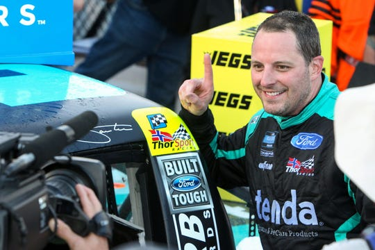 NASCAR Gander Outdoor Truck Series driver Johnny Sauter applies the winner's decal to his truck last season at Dover. He'll race for ThorSport again in 2020.