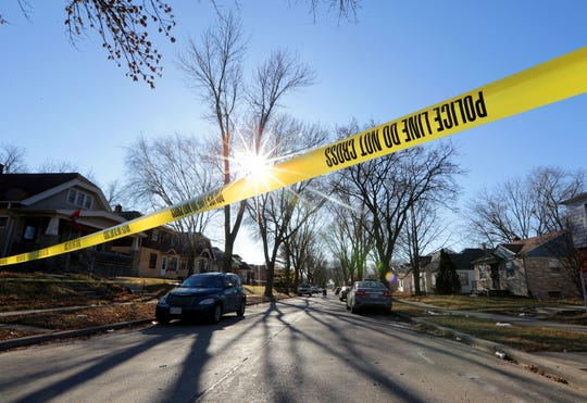 Police tape blocks the scene in the 5500 block of North 42nd Street as police investigate a homicide.