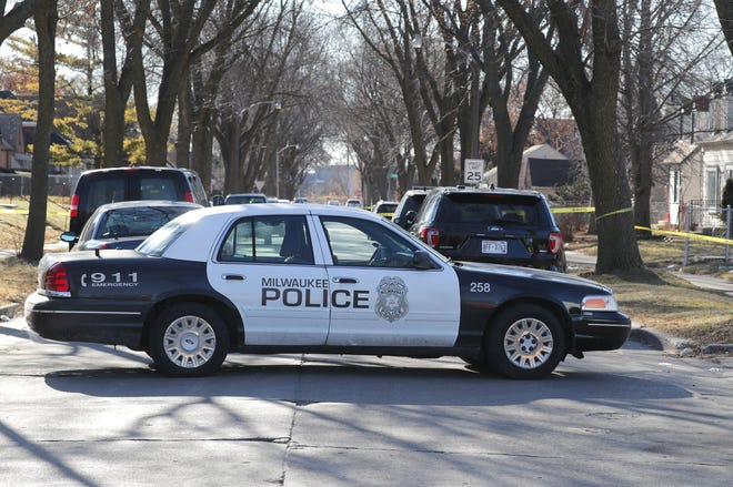 A Milwaukee police squad car blocks North 42nd Street as police respond to a fatal shooting in the  5500 block of North 42nd Street on Wednesday.