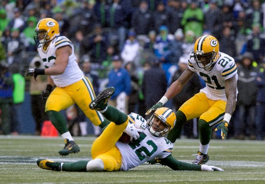 Green Bay Packers strong safety Morgan Burnett (42) intercepts the ball in the fourth quarter of the NFC Championship game against the Seattle Seahawks Sunday, January 18, 2015 in Seattle.